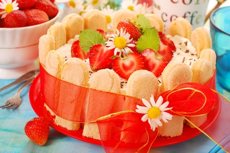 charlotte: charlotte cake with strawberry and whipped cream tied with red ribbon