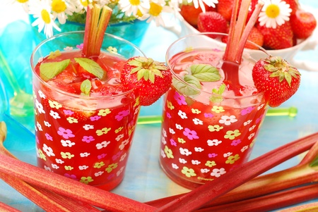 fresh strawberry and rhubarb  compote with mint leaves in glass photo