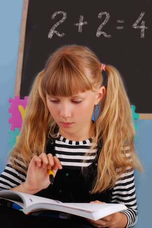 schoolgirl in the classroom learning on mathematics lesson Stock Photo
