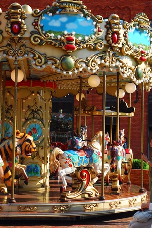 vintage children: beautiful vintage merry-go-round with horses  and other animals for kids Editorial