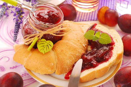 coffee jelly: sweet breakfast with croissant and homemade plum confiture