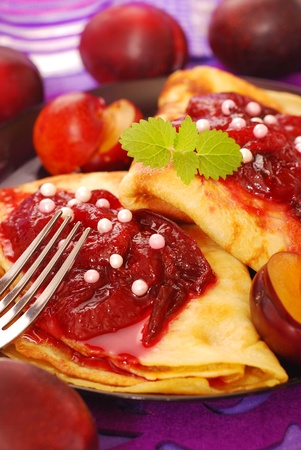 pancakes with homemade plum confiture and pearls topping photo