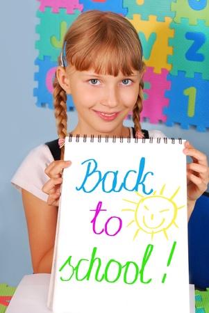 schoolgirl uniform: schoolgirl showing a card with text