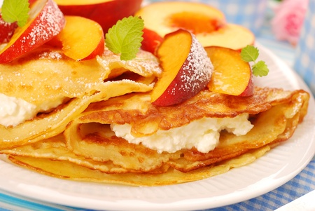 crepe: delicious pancakes with cottage cheese and fresh peach