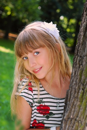 portrait of beautiful blond girl in the park  photo