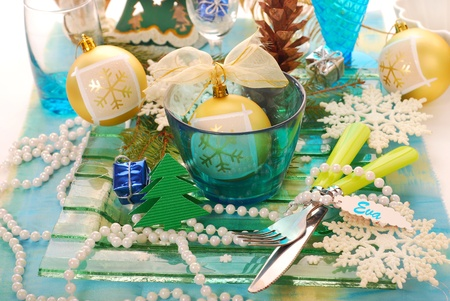 table decoration with blue bowl,snow flakes ,fir and cone for christmas photo