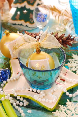 table setting with blue glass bowl and star shape plate  for christmas photo