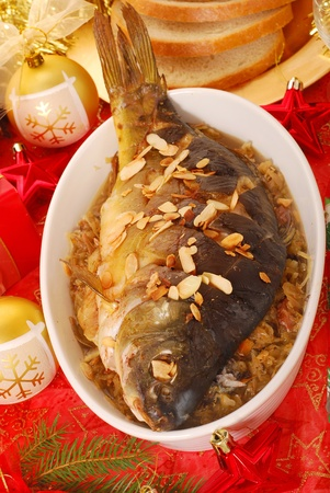 served: whole carp baked with flaked almonds served on sauerkraut (bigos) for  christmas