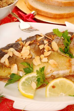 flaked: close up of  carp baked with flaked almonds  on  christmas table