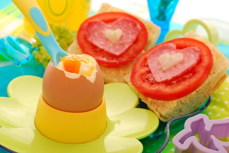 breakfast with soft boiled egg and sandwiches for child photo