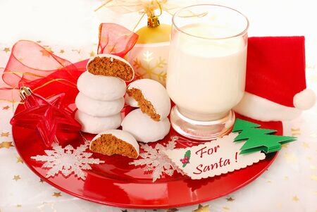 glass of milk and gingerbread cookies for santa claus photo