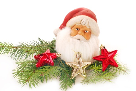 christmas decoration with head of santa claus figurine isolated on white  photo