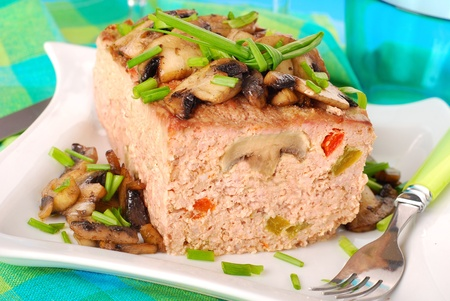 MEAT LOAF: homemade  baked meatloaf stuffed with mushrooms ,red and green pepper
