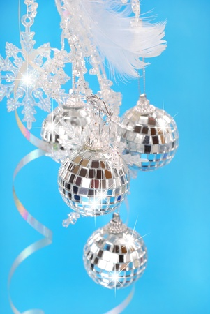 christmas decoration with shining mirror balls on blue background Stock Photo