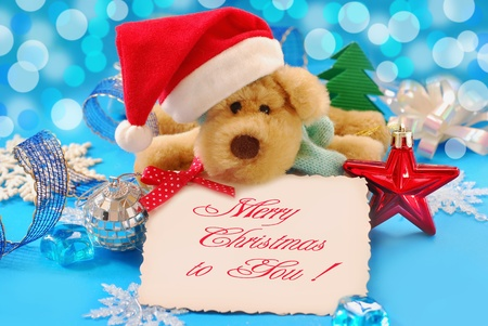 sweet puppy mascot in santa hat  holding banner with christmas greetings