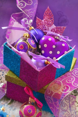 colorful shining gift boxes with beautiful christmas baubles photo