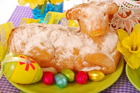 easter cake in the shape of lamb on festive table Stock Photo