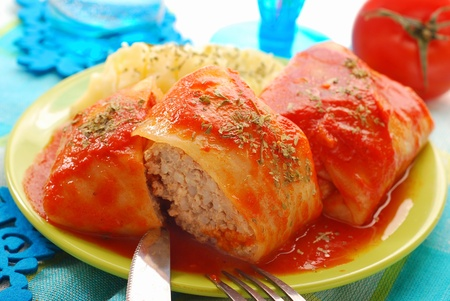 stuffed cabbage leaves rolled with minced meat and rice in tomato sauce as traditional polish dinner  photo