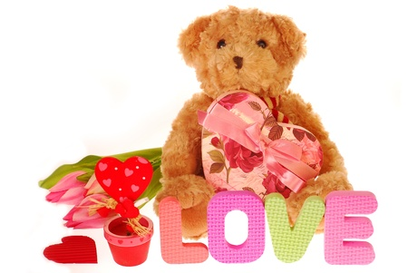 sweet teddy bear  with heart and valentine`s gifts isolated on white photo