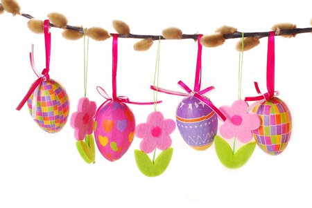 easter border with hanging colorful eggs and  felt flowers isolated on white Stock Photo