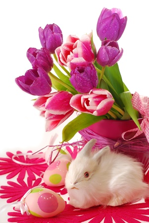 easter decoration with white bunny and bunch of purple tulips in vase isolated on white photo