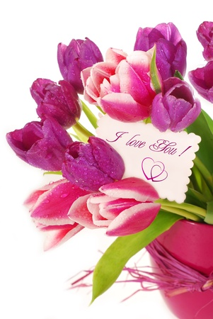 bunch of fresh pink and purple tulips in vase with greetings card  photo