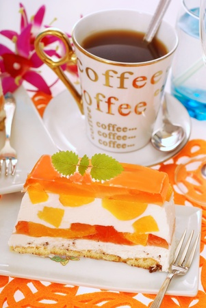 portion of peach cake with jelly layers and coffee photo