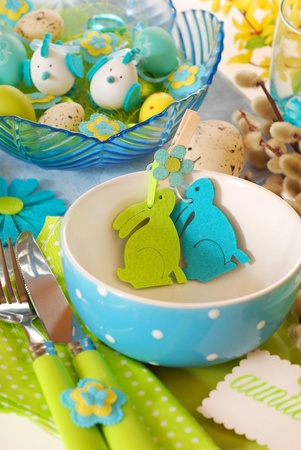 easter table setting in turquoise-pistachio colors  photo