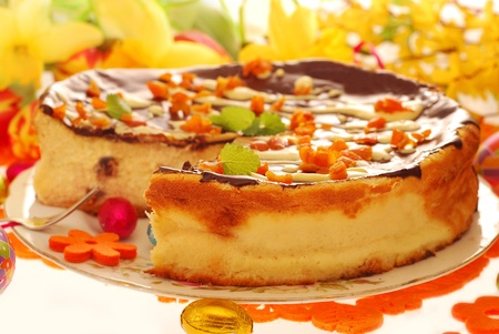 homemade cheese cake with raisins and candied orange peel poured chocolate for easter