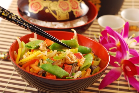 oriental dinner with bowl of deep fried chicken ,vegetables  and rice photo