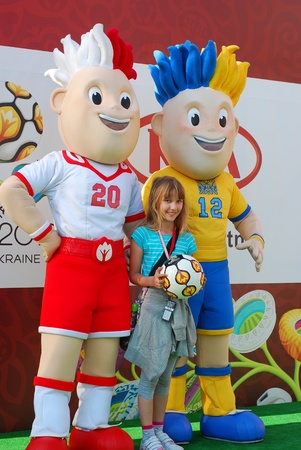 2012,05,05 ,Lodz-football weekend in shopping centre-Manufacture.young girl posing with official talismans of Euro 2012 -Slavek and Slavko