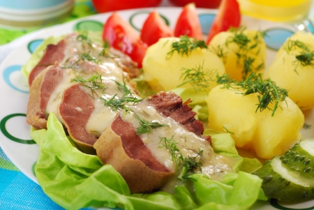 giblets: dinner with stewed pork tongue in horse radish and dill sauce, boiled potatoes,vegetables