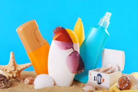 summer skin care and sun protection cosmetics arranged on the beach photo