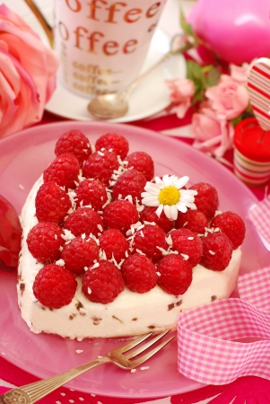 fresh raspberry cake with coconut flavor whipped cream on pink table  photo