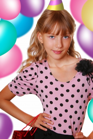 beautiful young girl in elegant dress on birthday party photo