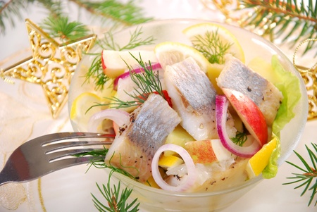 herring salad with apple and potato,lemon and dill for christmas Banco de Imagens