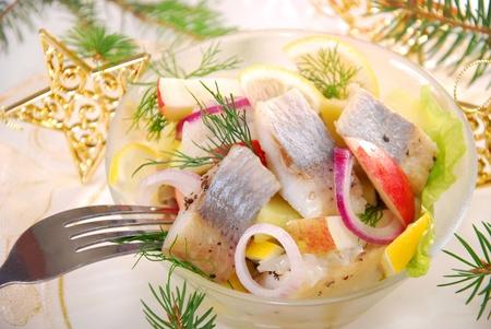 kipper: herring salad with apple and potato,lemon and dill for christmas Stock Photo