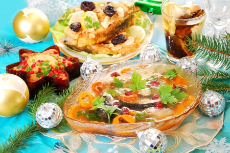 carp in jelly with carrot and cranberry and other traditional polish dishes on christmas table Standard-Bild