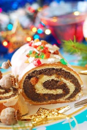 traditional polish poppy seed roulade cake with icing for christmas Stockfoto