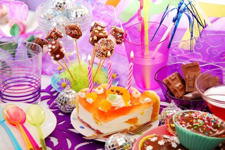 colorful decoration of birthday party table with cake and sweets for child Stock Photo