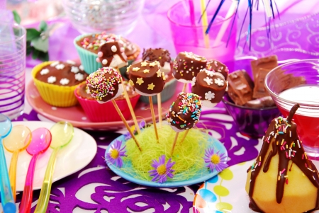 colorful decoration of birthday party table with homemade  sweets for child Standard-Bild