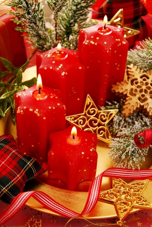 christmas decoration with red candles in star shape photo