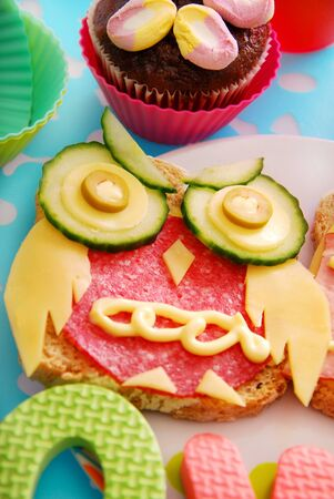 funny sandwich with owl made from cheese,sausage and vegetables for child photo