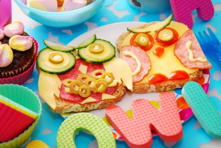 funny sandwiches with owl made from cheese ,sausage and vegetables for child