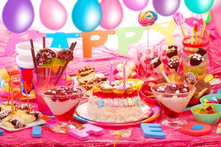 children party: birthday party with homemade torte and fruit sweets for children Stock Photo