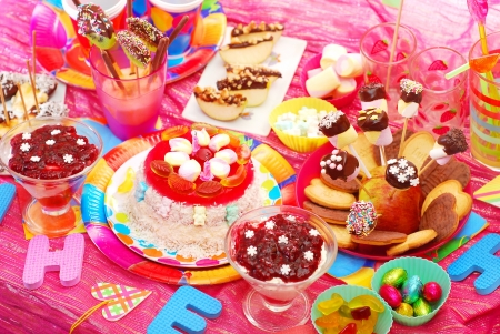 kids birthday party: birthday party with homemade torte and fruit sweets for children Stock Photo
