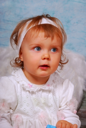 little baby girl with white wings as angel photo
