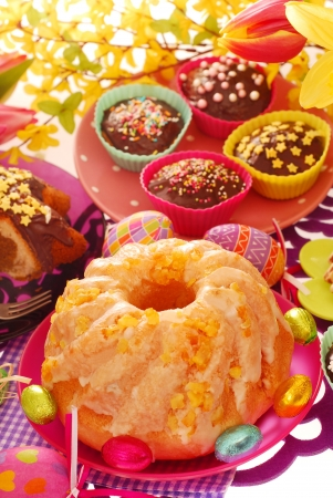 yeast ring cake decorated with icing and candied orange peel for easter photo