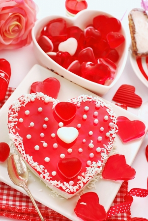 jelly cake in heart shape with white pearls topping for valentine`s party  photo