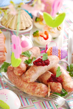 horseradish sauce: traditional polish white sausage with beetroot -horseradish sauce and other dishes on easter table Stock Photo